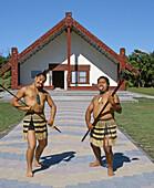 Maori challenge in front of meeting house Whakarewarewa Rotorua New Zealand