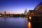 View over river Rhine towards the old town of Cologne and the Groß St Martin church, Cologne cathedral and Hohenzollern Bridge, Cologne, Rhine river, North Rhine-Westphalia, Germany
