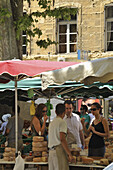 People at a cheese stall at the market, Aix-en-Provence, Provence, France, Europe