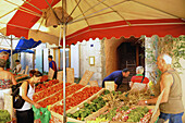 People at a vegetable stall at the provencal market at Buis-les-Baronnies, Haute Provence, Provence, France, Europe