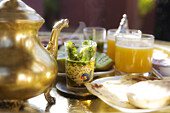 Moroccan breakfast with peppermint tea, Kiwi and orange juice, Riad Kaiss, Marrakech, Morocco, Africa
