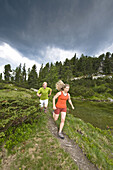 Couple jogging, Zillertal, Tyrol, Austria