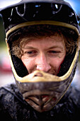 Mountain biker wearing helmet, portrait, Austria