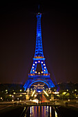 Blue illuminated Eiffel Tower with EU stars, Paris, France