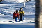 Two men hiking through snow, Norway