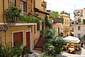 Sunny alley with restaurant in Taormina, Messina Province, Sicily, Italy, Europe