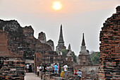 Tourists at Wat Mahathat temple at sunset, old kingdomtown Ayutthaya, Thailand, Asia