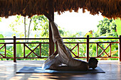 Indian yogi and yoga teacher at the Barefoot at Havelock Resort with a view across the rainforest, Radha Nagar Beach, Beach 7, Havelock Island, Andamans, India