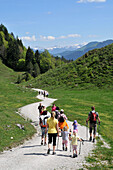 Family with children hiking near Scheffau at Wilder Kaiser, Tyrol, Austria
