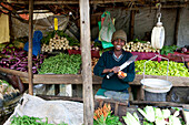 Young boy at an vegetable stall on the side of the road, Nuwara Eliya, Highland, Sri Lanka, Asia