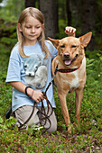 A girl with a dog, Västernorrland, Sweden, Europe