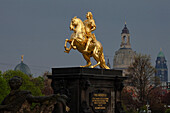 Der goldene Reiter, The golden equestrian sculpture of King Augustus the Strong, August II, with dome of the Frauenkirche, Church of our Lady and town hall tower in the background, Dresden, Saxony, Germany