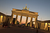 Brandenburg gate with Quadriga on top of in Berlin at sunset