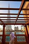 Arab Man watching Dubai Fountain at Burj Khalifa, highest Skycraper in the World, 828 meter, Burj Dubai, Dubai UEA