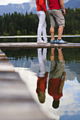Young couple on jetty, lake Lautersee, Mittenwald, Werdenfelser Land, Upper Bavaria, Germany
