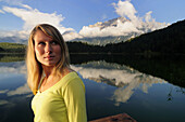 Young woman near lake Lautersee, Mittenwald, Werdenfelser Land, Upper Bavaria, Germany