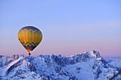 Hot-air balloon flying above Alpspitze, Jubilaeumsgrat and Zugspitze, aerial view, Garmisch-Partenkirchen, Wetterstein range, Bavarian alps, Upper Bavaria, Bavaria, Germany, Europe