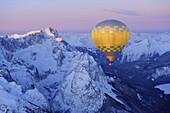 Aerial view of hot-air balloon flying above Zugspitze and Waxensteine, Garmisch-Partenkirchen, Wetterstein range, Bavarian alps, Upper Bavaria, Bavaria, Germany, Europe