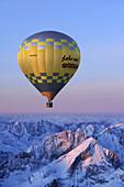 Aerial view of hot-air balloon flying above Alpspitze, Garmisch-Partenkirchen, Wetterstein range, Bavarian alps, Upper Bavaria, Bavaria, Germany, Europe