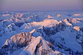 Aerial view of Alpspitze, Jubilaeumsgrat and Zugspitze in the morning light, Mieminger range in background, Garmisch-Partenkirchen, Wetterstein range, Bavarian alps, Upper Bavaria, Bavaria, Germany, Europe