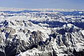Pala range in winter, with Plattkofel, Langkofel, Sella range, Marmolada range, Zillertal range in background, aerial photo, Dolomites, Venetia, Italy, Europe