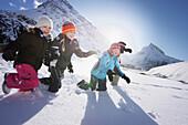 Children playing in snow, Galtuer, Paznaun valley, Tyrol, Austria