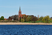 St. Mary's Church and water tower at Great Wuennow in Roebel, Mecklenburg lake District, Mecklenburg-Western Pomerania, Germany