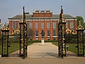 View through a gate onto Kensington Palace, England, Great Britain, Europe
