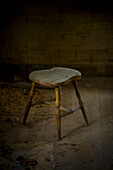 One old wooden stool in the dark room