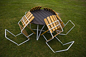 Four chairs with table on the lawn, garden furniture