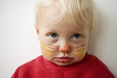 Little boy with painted face