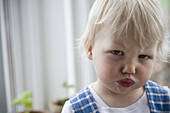 Angry little girl pounting her lips