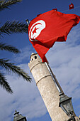 The tunisian flag in front of Sousse Ribat, Tunisia. It the most famous and wellknown ribat in Tunisia. It was built 787, 821 AD.