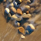 Small stones in water´s edge