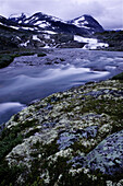 Streaming water at night in Joutunheimen, Norway