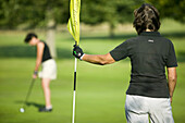 Women are playing golf