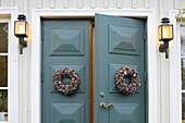 Blue doors with wreath