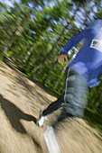 Man runs in Kronoskogen, angelholm, on a fitness path, Skane, Sweden