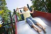 Girl on a playground in Hembygdsparken, angelholm, Skane, Sweden