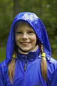 Girl in blue rainjacket