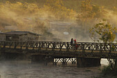 People on a bridge in morning mist, Paksong at Bolaven Plateau, South Laos, Asia