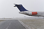 Airport taxiway in snowfall, Munich airport, Bavaria, Germany