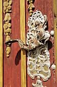 Ornamental doorknob on the church door, St. Georg, Dinkelbuehl, Bavaria, Germany