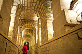 Woman in a corridor of the catacombs of Paris, Les Catacombes de Paris, Paris, France, Europe