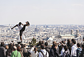 Street artist with football and spectators at Montmartre, Paris, France, Europe