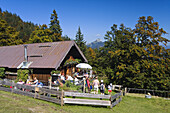 Hikers taking a rest at the Mitterhütter alpine hut, Mountain hiking, Hochalm, Alps, Upper Bavaria, Germany, Europe