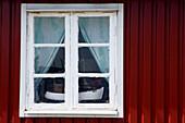 Ship model of a fishing boat standing in a window, Kaseberga, Ystad, Skane, South Sweden, Sweden