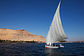 Felucca on the river Nile, mausoleum of Aga Khan in the background, Aswan, Egypt, Africa