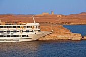 Cruise ship and the temples of Dakka and the Maharraqa (right), Lake Nasser, Egypt, Africa