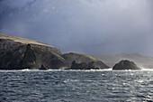 Coastline and islands under clouded sky, Isla Hornos, Magallanes y de la Antartica Chilena, Patagonia, Chile, South America, America